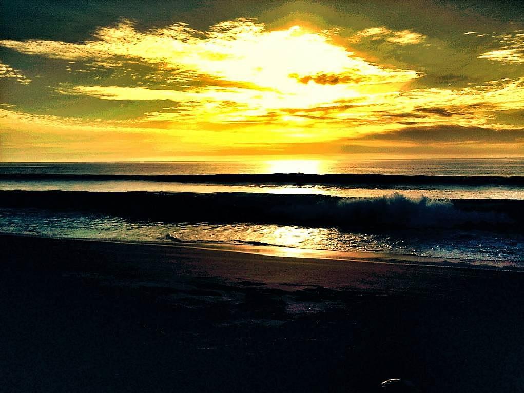 7. Comporta'da gün batımını mutlaka izleyin.
